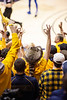 Fans celebrate after a three point shot. WVU Men's Basketball took on Kansas on February 13, 2020 in the Coliseum. (WVU Photo/Parker Sheppard)