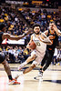 Jermaine Haley presses past two defenders. WVU Men's Basketball took on Oklahoma State on February18, 2020 in the Coliseum. (WVU Photo/Parker Sheppard)