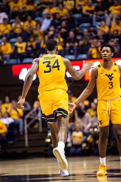 Oscar Tshiebwe gives Gabe Osabuohien a high five. WVU Men's Basketball took on Texas Tech on January 11, 2020 in the Coliseum. (WVU Photo/Parker Sheppard)