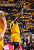 Oscar Tshiebwe points up while walking down the court. WVU Men's Basketball took on Texas Tech on January 11, 2020 in the Coliseum. (WVU Photo/Parker Sheppard)
