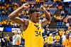 Oscar Tshiebwe flexes after winning the game. WVU Men's Basketball took on Texas Tech on January 11, 2020 in the Coliseum. (WVU Photo/Parker Sheppard)