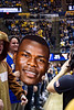 Student holds a cut out of Oscar Tshiebwe's head. WVU Men's Basketball took on TCU on January 14, 2020 in the Coliseum. (WVU Photo/Parker Sheppard)