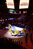 Cheerleaders circle the court with flags as the Mountaineers prepare to take the court. WVU Men's Basketball took on TCU on January 14, 2020 in the Coliseum. (WVU Photo/Parker Sheppard)