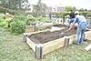Nikki Byrne-Hoffman and Katrina Stewart along with the help of volunteers build their second garden bed at the Campus Food Garden on the Evansdale campus, October 7th, 2021.    (WVU Photo/Margaret Schiffer)