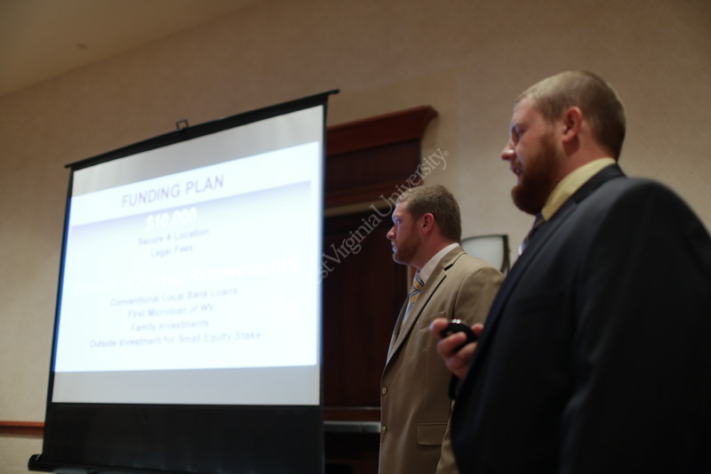 WVU students Dereck Price and Evan Rose practice their presentation at the 2015 Business Plan Competition Finals at the Waterfront Place Hotel.  They are hoping to win $10,000 and start a new business called Country Road Meats. Price (the taller of the 2 students) and Rose (wearing the darker colored jacket) will be featured in WVUToday's Meet the Grads. 4/10/2015 Photo by Scott Lituchy / West Virginia University