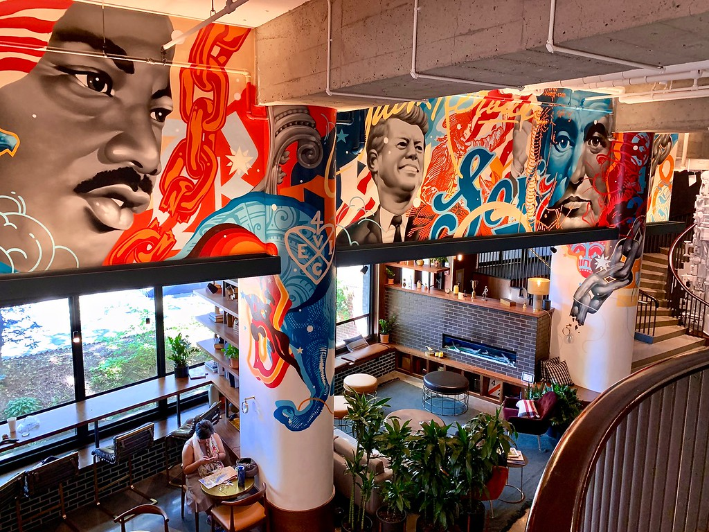 lobby of the Revolution Hotel in Boston, featuring a mural by Tristan Eaton