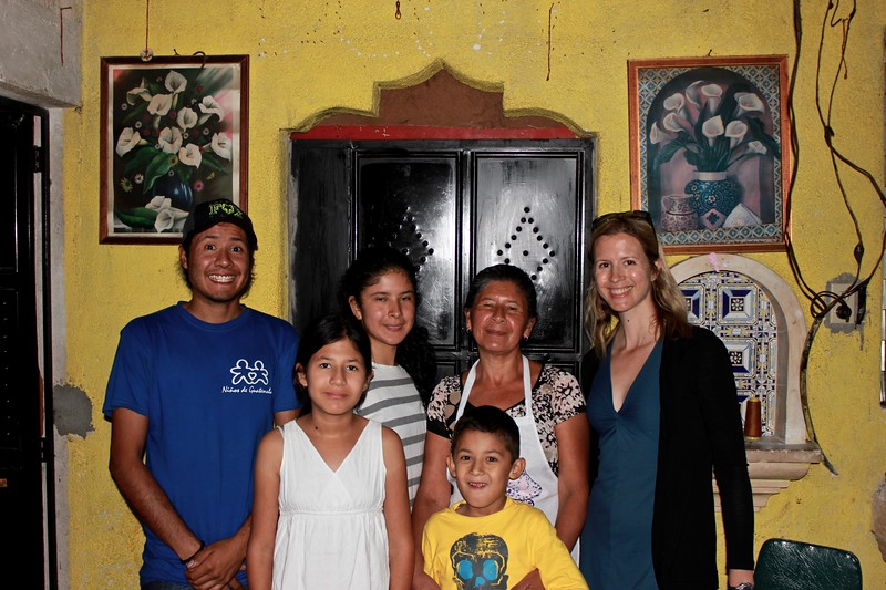 Brianne Miers with Ninos de Guatemala tour guide Christian and his family in Antigua