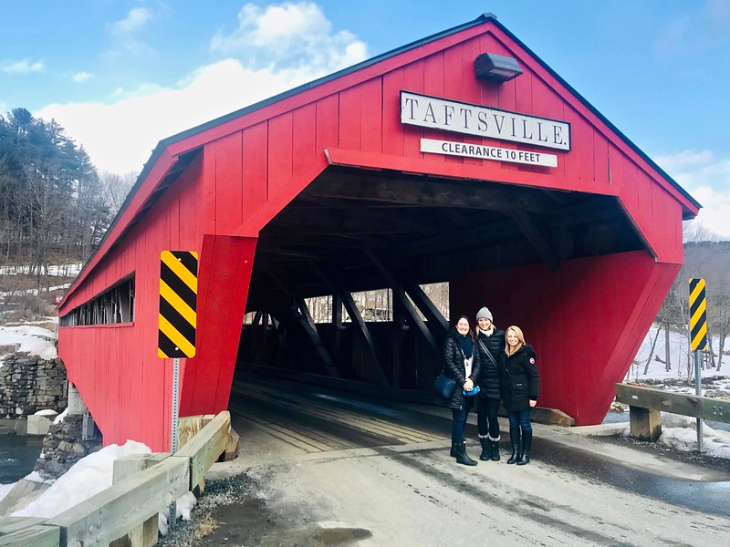 Brianne Miers with friends in front of the Taftsville Covered Bridge in Woodstock, Vermont