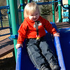 Lincoln takes a slide (Tessa watching over his shoulder).