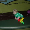 Lincoln exploring the water bed in the toddler area.