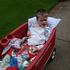 Having a Popsicle while getting to have a wagon ride to the garden. He was pretty stiff and uncomfortable but he toughed it out. Such a strong kid!