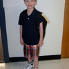 Chandler in front of his classroom on the first day of 1st grade