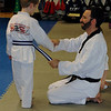 Handshake and now a blue belt with white stripe! 1.24.11