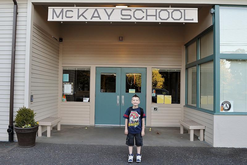 Chandler in front of his school, Sept 4, '12.