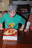 Blowing out his candles.
