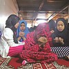 Muslim kids pray during Eid'l Adha