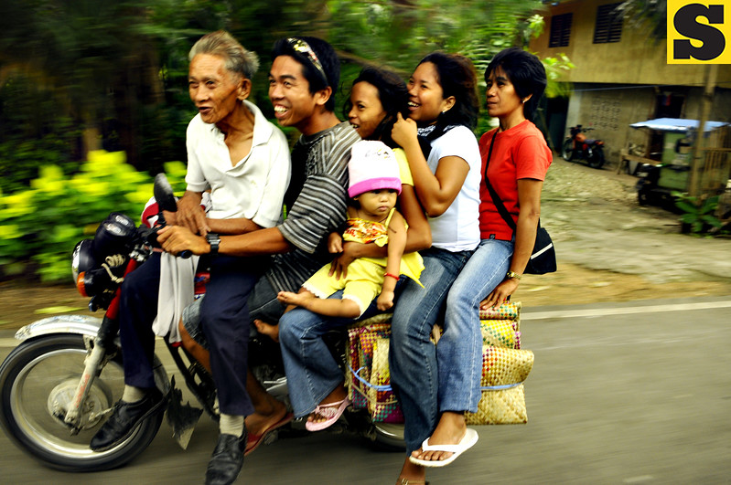 09-09-09<br /> Photo taken-09-08-09<br /> ONLY IN THE PHILIPPINES. Passengers in southern Cebu enjoy the ride of a habal-habal  unmindful of the risk.	<br /> (SUN.STAR FOTO/ALEX BADAYOS)