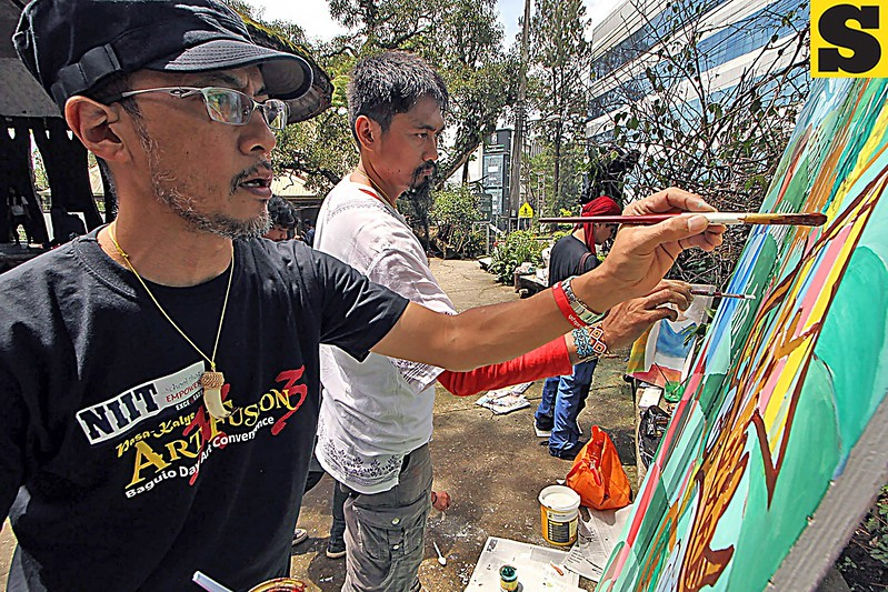 Davao artists Daryll Descallar and Victor Dumaguing
