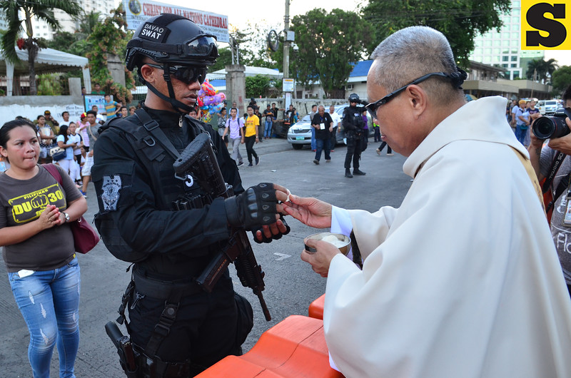 Swat member during Holy Communion