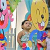 DAVAO. Children stare at the bunnies used as decorations inside SM City Davao on Monday. (King Rodriguez)