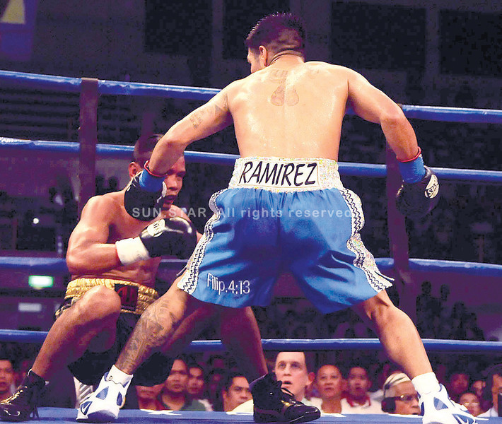 Rey Bautista staggers after gettng hit by a solid punch from Jose Ramirez in the first round of their title fight. (Arni Aclao of Sun.Star Cebu)
