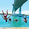 SUMMER HEADLONG. A clique under the Marcelo B. Fernan escapes the morning heat by taking a plunge right into the Mactan Channel. (Alan Tangcawan of Sun.Star Cebu)