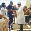 Wilfredo Abaquita receives his diploma from Naga City Jail Warden Dennis Aliño and lawyer Christine Chiong, Naga City Mayor Valdemar Chiong's executive secretary, during the 3rd Commencement Exercised of the DepEd's Alternative Learning System program. (Justin K. Vestil)