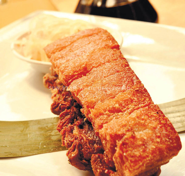 DEEP-FRIED DELIGHT. Liempo slowly simmered with local aromatic herbs and deep-fried to perfection.