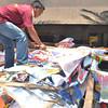 PORBIDA! Puno ang dump truck sa City Engineer's Office sa mga gipanglangkat nga posters sa mga kandidato sa unang distrito sa dakbayan sa Davao niadtong Lunes sa buntag sa 'Operation Baklas', timailhan nga daghang kandidato wa misubay sa balaod sa Comelec. (Seth delos Reyes)