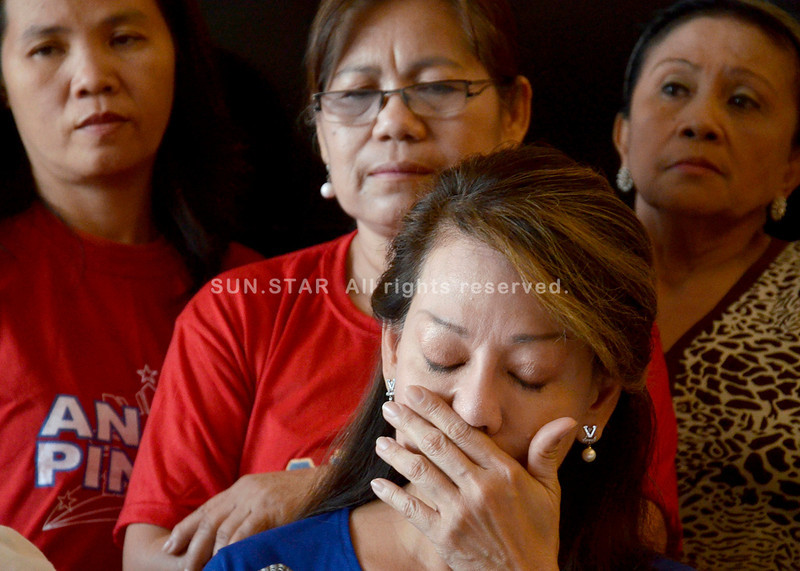 SPARE MY FAMILY.  Congressional candidate Joji Ilagan-Bian is emotional as she answers various issues recently hurled against her husband, which saw print in a local newspaper not Sun.Star Davao, during a press conference held at her school, IChef, on Tuesday. (King Rodriguez)