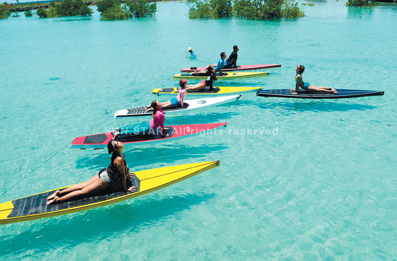 FLOATING COBRAS.  By themselves, yoga and stand-up paddleboard surfing demand balance. Enthusiasts are finding ways to combine both in Cebu, for an extra challenge; this photo shows yogis and yoginis performing the cobra pose on top of their boards, which are wider than regular surfboards.  (Allan Defensor)