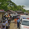 BLIND CURVE. A truck, carrying 31 people and 19 animals, crashes into a concrete house (top) in Barangay Guadalupe, Carcar City. The impact caused some of the passengers to be thrown off from the truck and smashed against the wall of the house. Blood splattered on the walls.<br />  (SUN.STAR FOTO/AMPER CAMPAÑA)