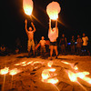 "THE LIGHT ON THE ISLAND. A family releases lanterns into the sky, while spending the Holy Week taking in the white sand beaches and other attractions of Santa Fe in Bantayan Island. The words ""Holy Week"" were dug in the sand, then illuminated by candles. (Sun.Star Foto/Alex Badayos)"
