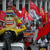 """DAVAO. Militant groups carry an effigy of President Aquino """"noynoying"""" or doing nothing, as they chided the government's inaction to alleviate the plight of the labor sector. (King Rodriguez)"""