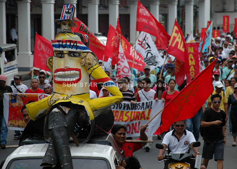 "DAVAO. Militant groups carry an effigy of President Aquino ""noynoying"" or doing nothing, as they chided the government's inaction to alleviate the plight of the labor sector. (King Rodriguez)"