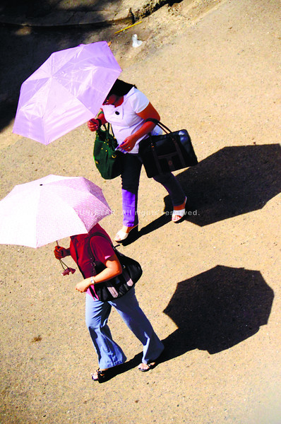 SUMMER, HOT, HOT, HOT. Bring your umbrellas, folks. The weather bureau says there's some rain on the forecast, but mostly more heat as the summer gets into full swing.  (Amper Campaña)