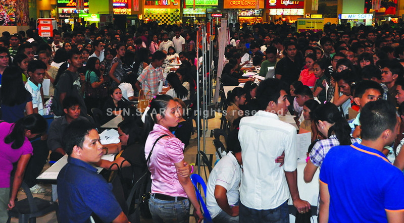 BACOLOD. Thousands of hopefuls flocked to SM City Bacolod to seek employment during the job fair Tuesday, May 1. (Merlinda Pedrosa)