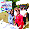 PLANS TO RISE.  Cebu Gov. Gwendolyn Garcia (left) points out to Justice Secretary Leila de Lima some features of the National Bureau of Investigation (NBI) regional office that's being built in a Capitol-owned compound. Both women are being talked about as potential candidates for the Senate next year, but have yet to reveal their decisions.  (Amper Campana)