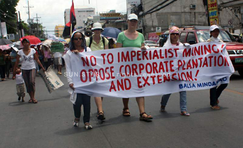 CAGAYAN DE ORO. Tropical Storm Sendong survivors march through the streets of Cagayan de Oro Saturday to protest the destruction of the environment through mining and corporate plantation and expansion. (Joey P. Nacalaban)
