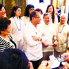 CEBU. President Benigno Aquino III mingles with some delegates of the World Electronics Forum at the Shangri-La Mactan Island Resort and Spa. He is flanked by Trade Secretary Gregory Domingo (to his left) and Lapu-Lapu City Mayor Paz Radaza. (Allan Cuizon)