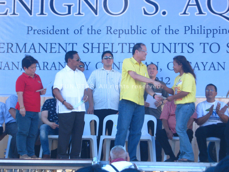 CAGAYAN DE ORO. President Benigno Aquino leads the ceremonial turnover of houses and livelihood assistance to survivors of Tropical Storm Sendong at the Canitoan relocation site in Cagayan de Oro Friday morning. (Loui S. Maliza)