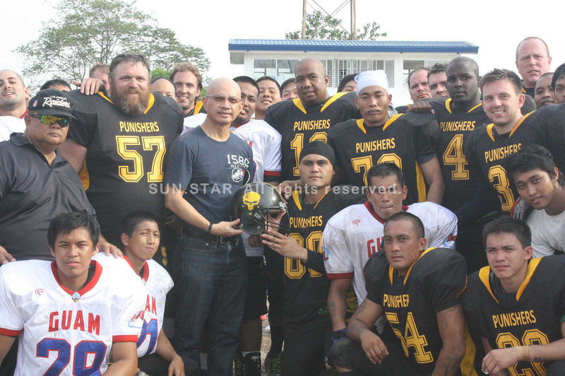 PAMPANGA. The PH Punishers and Guam All Stars hand over a symbolic American football helmet to Vice Governor Yeng Guiao for the Capitol's support of the games held at Challenger Field-Clark. (Jovi T. De Leon)
