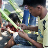 "CAGAYAN DE ORO. Children in St. Augustine Cathedral Church in Cagayan de Oro enjoy helping their parents make ""palaspas"", a cross made of palm leaves in time for the Palm Sunday. (Joey P. Nacalaban)"
