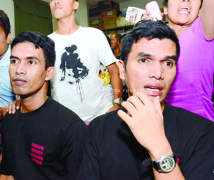 CEBU. Brothers Niño (right) and Josebil Bacolod react calmly, but shed some tears after hearing the court's verdict: the conviction of their brother-in-law, Rep. Ruben Ecleo Jr., for the death in January 2002 of their sister Alona, who was studying to be a doctor. (Amper Campaña)