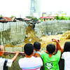 CEBU. Neighbors peer into the construction site of Horizons 101 in Barangay Cogon-Ramos, Cebu City, where a portion of the retaining wall in an excavation gave way. (Sun.Star photo/Arni Aclao)