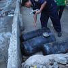 CEBU. SFO2 Emiliano Daño checks the tanks when firefighters rushed to the scene on Thursday, August 30, when an auto LPG tank exploded in Sitio Paglaum, Barangay Calamba, Cebu City.(Allan Defensor)