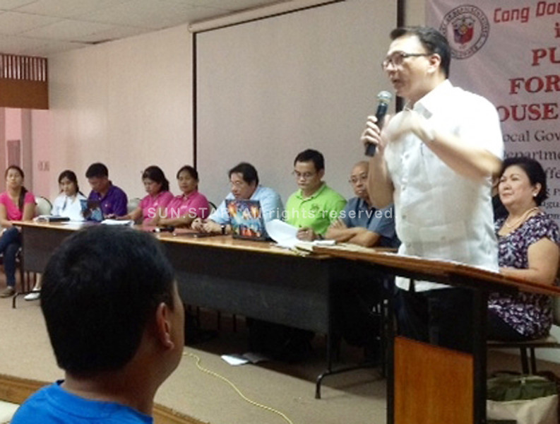 BACOLOD. Representative Anthony Golez Jr. explains during the public forum at UNO-R Thursday that House Bill 6069 is not meant to privatize public hospitals but to improve the delivery of health care. (Carla N. Canet)