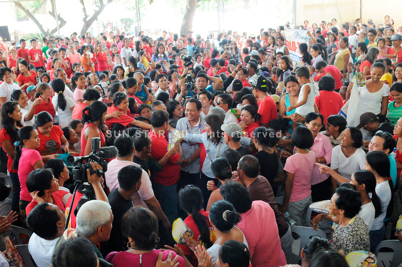 CONVENTION. Rep. Pablo John Garcia (Cebu, 3rd district) and Gov. Gwen Garcia find themselves in the middle of the crowd during the convention of a new opposition party in Consolacion, Cebu. (Sun.Star Photo/Allan Defensor)
