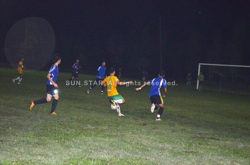 BACOLOD. Reynald Villareal penetrates the Ceres FC defense en route to scoring the first goal for the Green Archers during the Saturday friendly at the North pitch. (Butch S. Bacaoco)