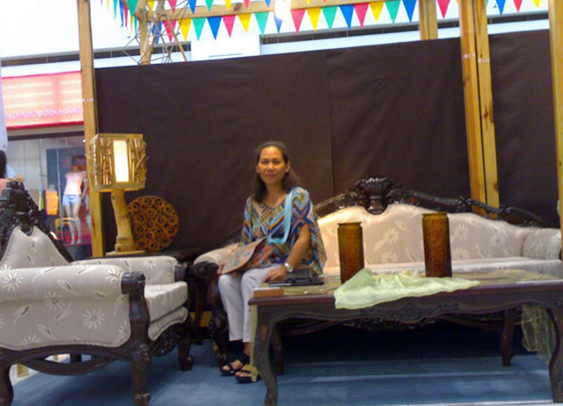 CAGAYAN DE ORO. Eliza L. Singidas, owner of Singidas Furniture, models her product at the opening of the seven-day regional trade fair at the Entrance 3 of SM City Cagayan de Oro. The exhibit is part of the annual Feast of St. Augustine on August 28. (Loui S. Maliza)